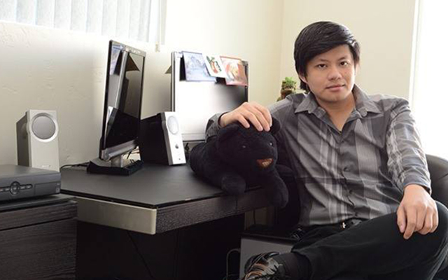 Photo of computer science lecturer Quang Bach at his desk. He is a newcomer to the computer science and engineering department in Fall 2017.