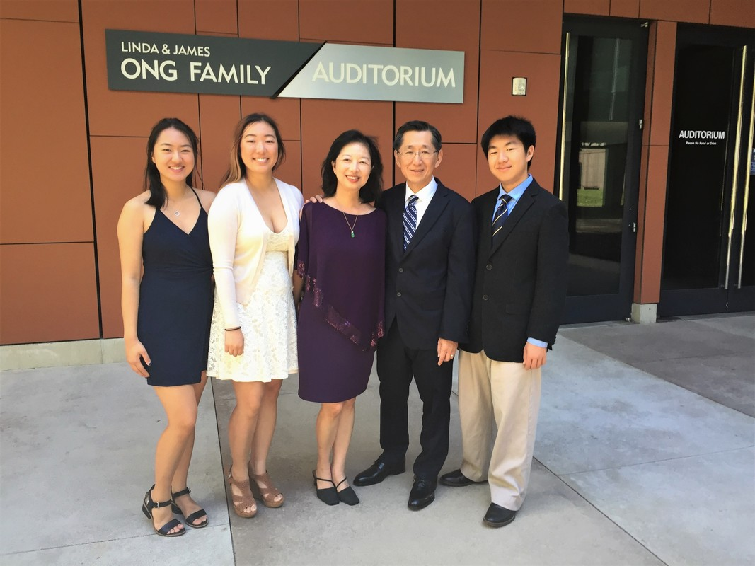 The Ong Family pose in front of the Linda & James Ong Family Auditorium. Photo Credit: Sandy Dempsey.