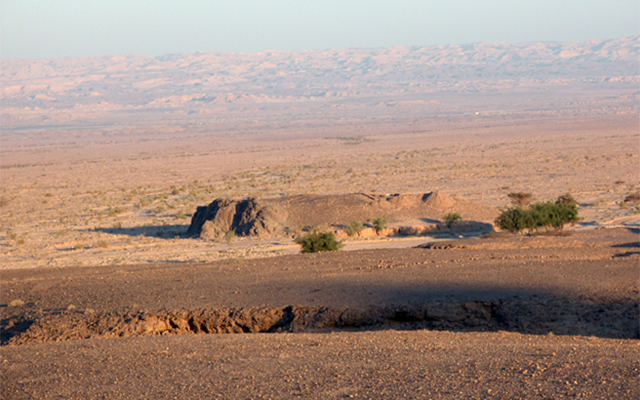 panoramic view of outcropping in Jordanian desert, Tel Tifdan, where artifacts were excavated for use in the study of Earth's magnetic field