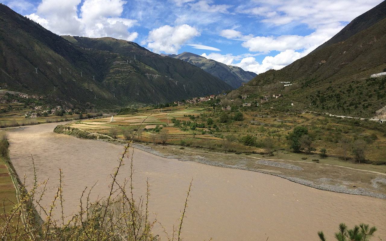 Fields in a valley in high-altitude Eastern Tibet- photo by Jade d'Alpoim Guedes.
