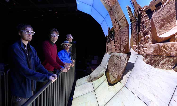 """Image: Wide-Angle Virtual Environment (WAVE) curved wall array of 35 55"""" commercial LCD monitors."""