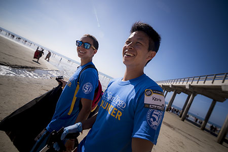 UC San Diego students volunteer on the beach.