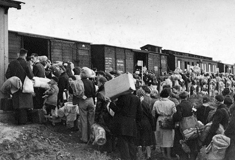 Image: 'Jews boarding a deportation train at Westerbork transit camp in the Netherlands.'