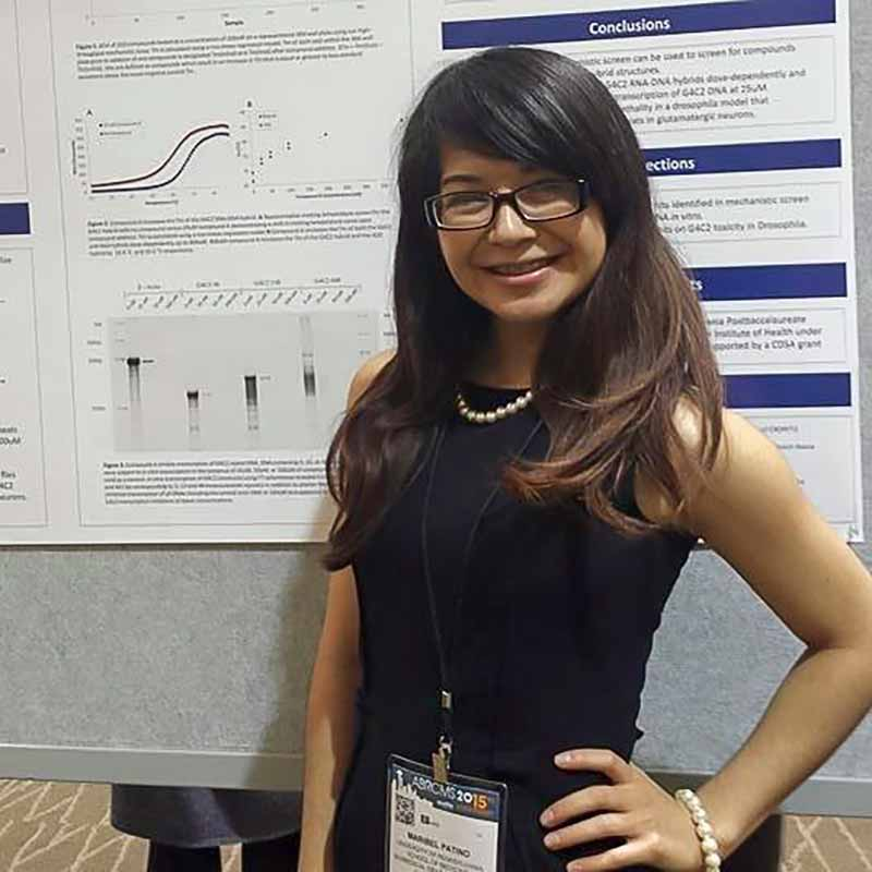 Maribel with a research poster