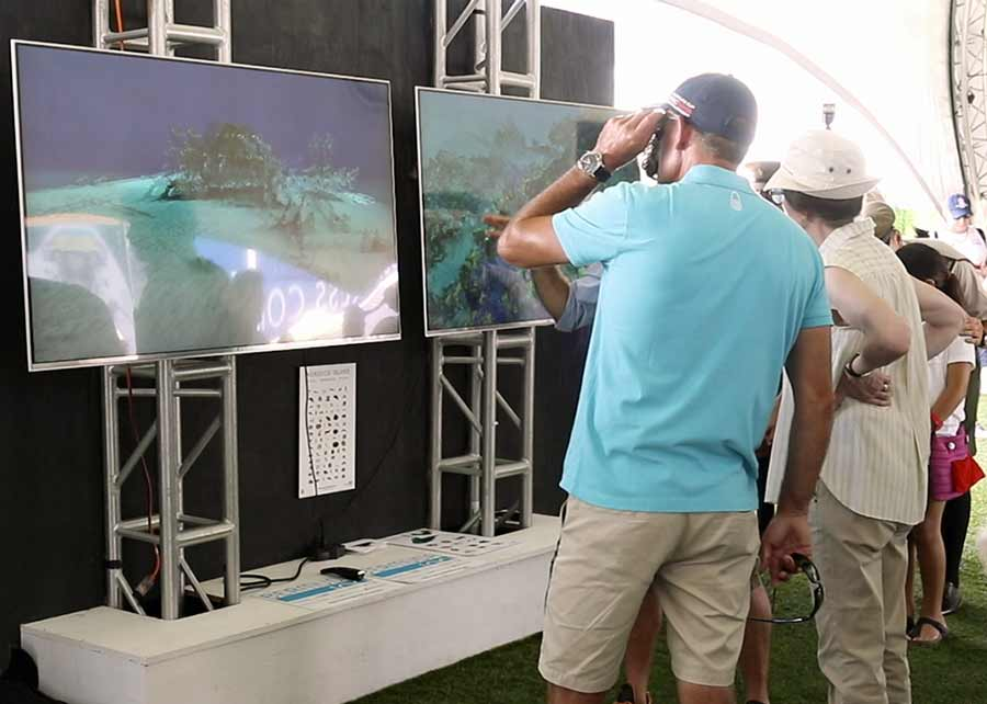Image of Visitors trying the Bermuda 100 technology