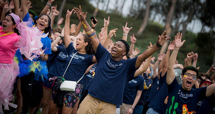 Cheering students - photo by Erik Jepsen/UC San Diego Publications