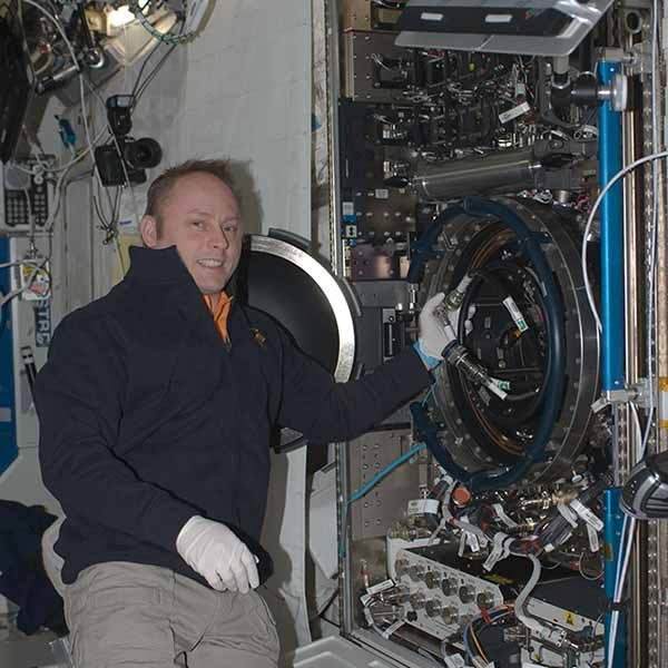 Astronaut Mike Fincke pictured to the left of the Combustion Integrated Rack facility installed in the Destiny module of the ISS shortly after installation. Photo: NASA