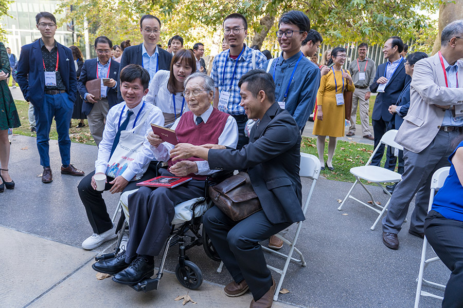 Bert Fung at birthday party with fellow researchers