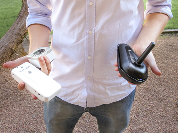 Devin Lundberg holds the three devices the researchers examined