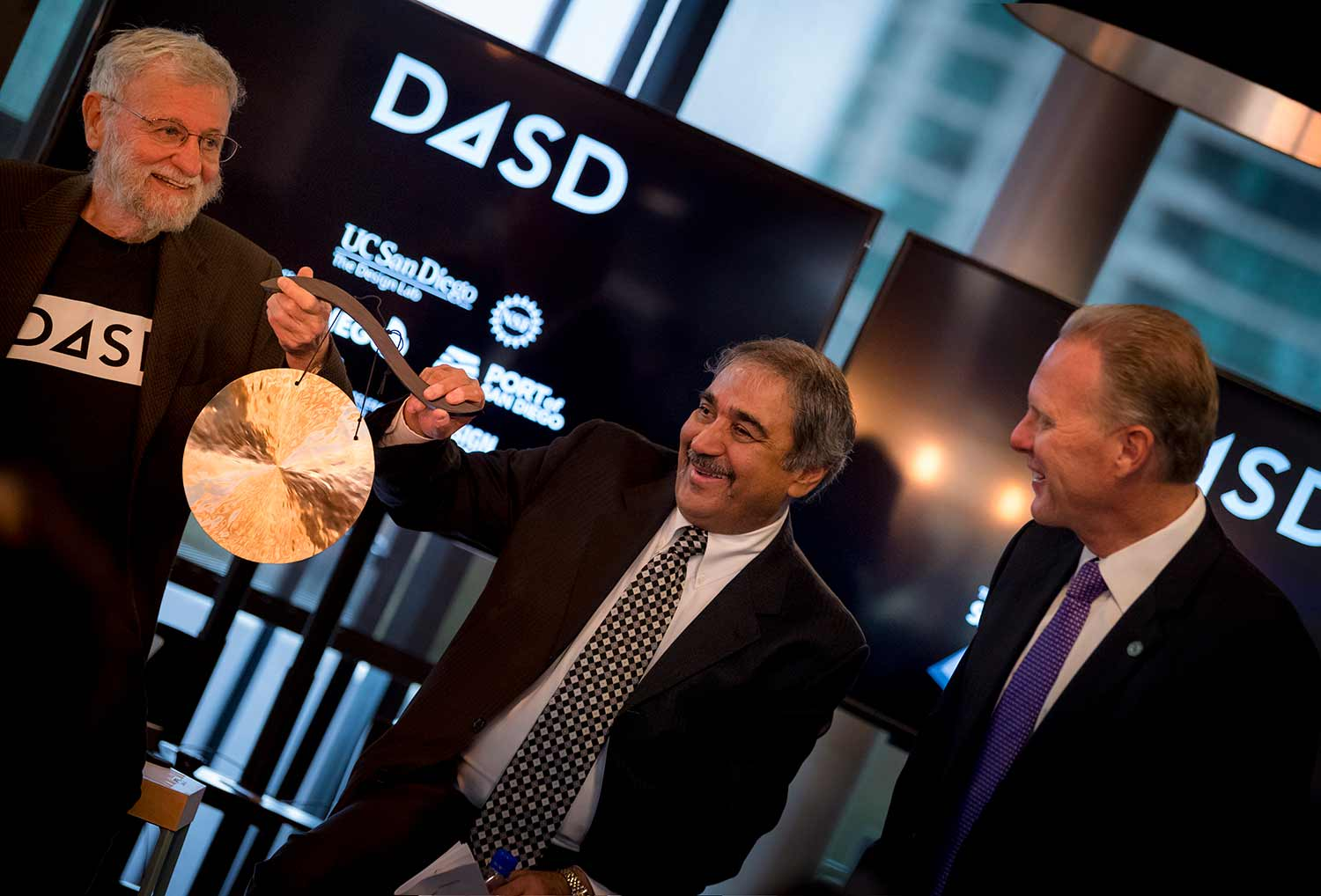 Don Norman, Pradeep Khosla and Kevin Faulconer bang a gong to kick off D4SD