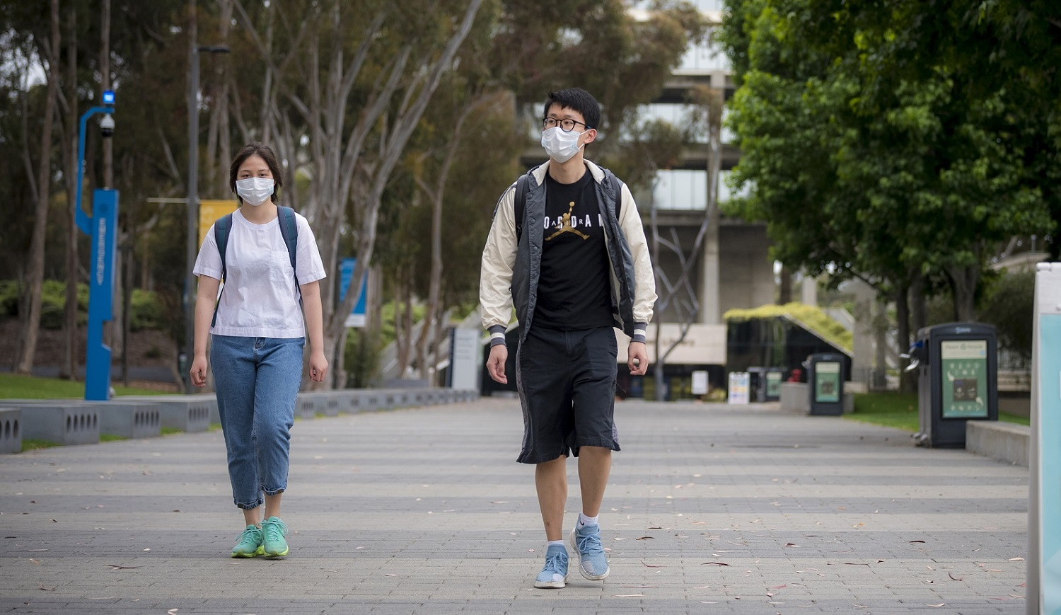 two students wearing facemasks at UCSD