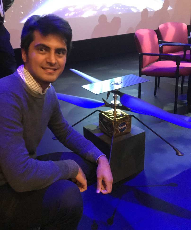 Alimo with a model of the Ingenuity helicopter.