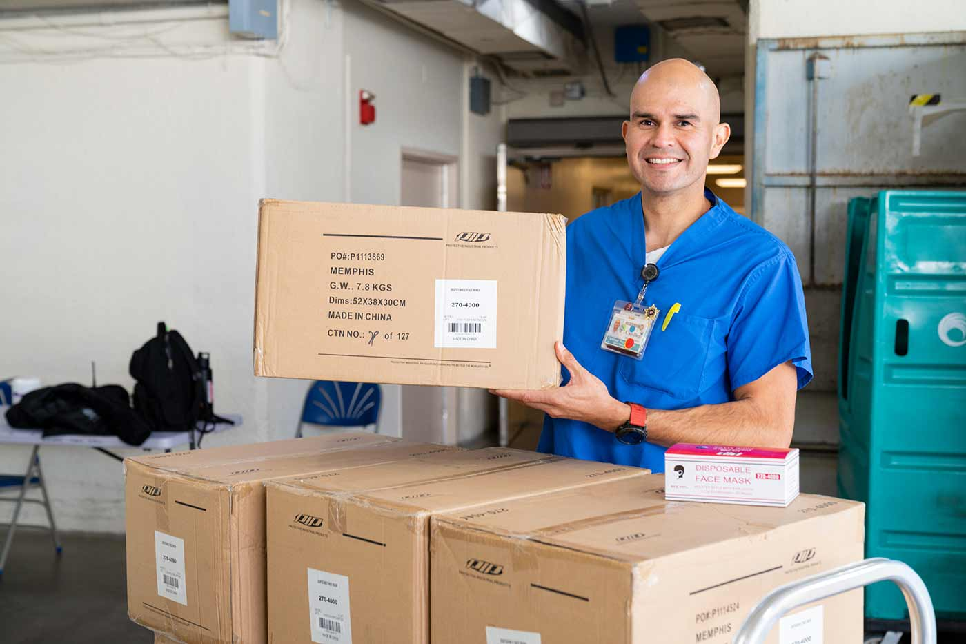 Employee with donation boxes