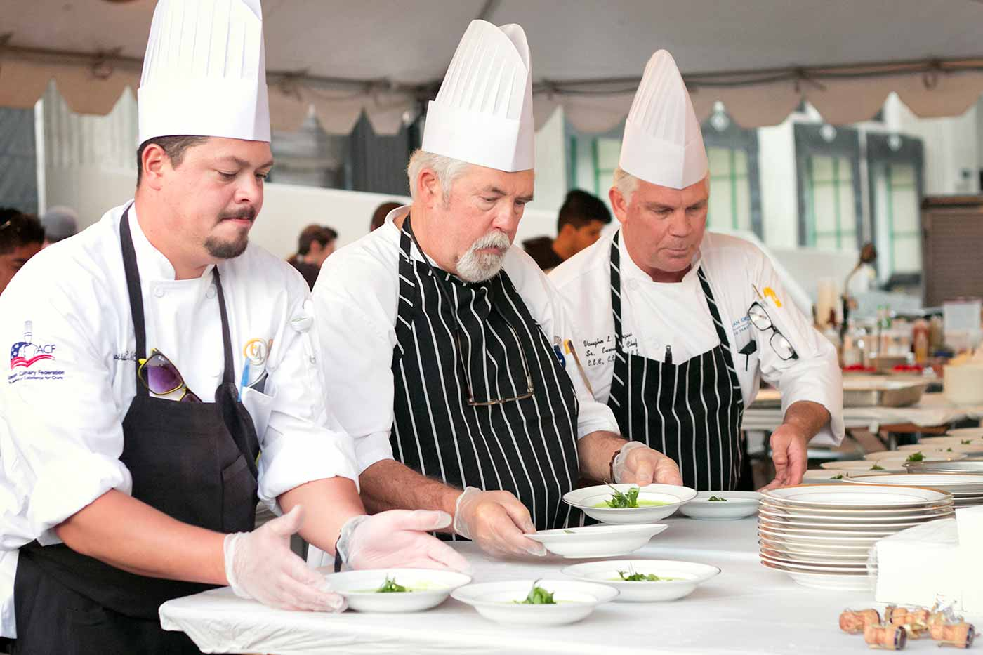 Photo: UC San Diego Executive Chef Vaughn Vargus (right), with UC San Diego chefs Dave Gardinier and Tiago Battastini