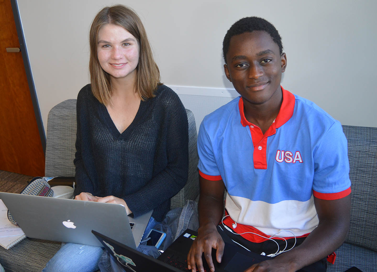 Data Science student Hannah Peterson and hacking partner Luyanda Mdanda with computers they used to win top hackathon prize