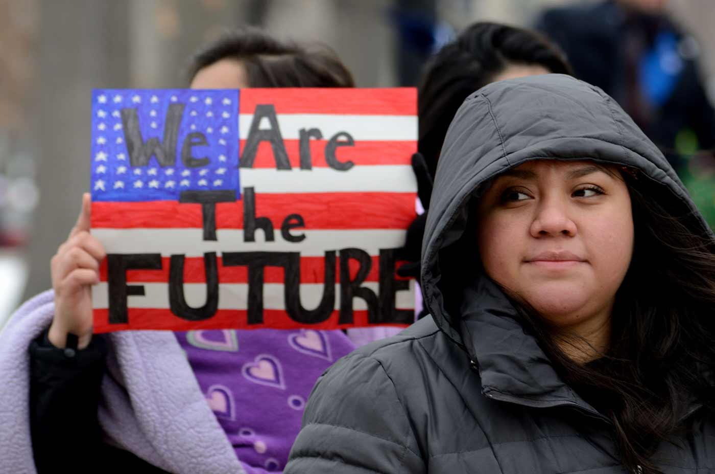 Women holding We Are the Future flag poster