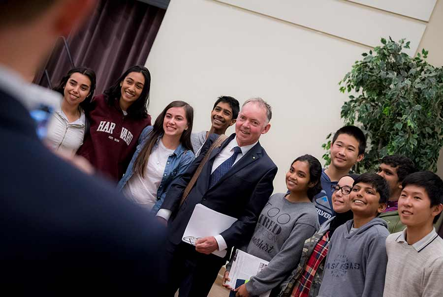 Graham Farquhar with high school students
