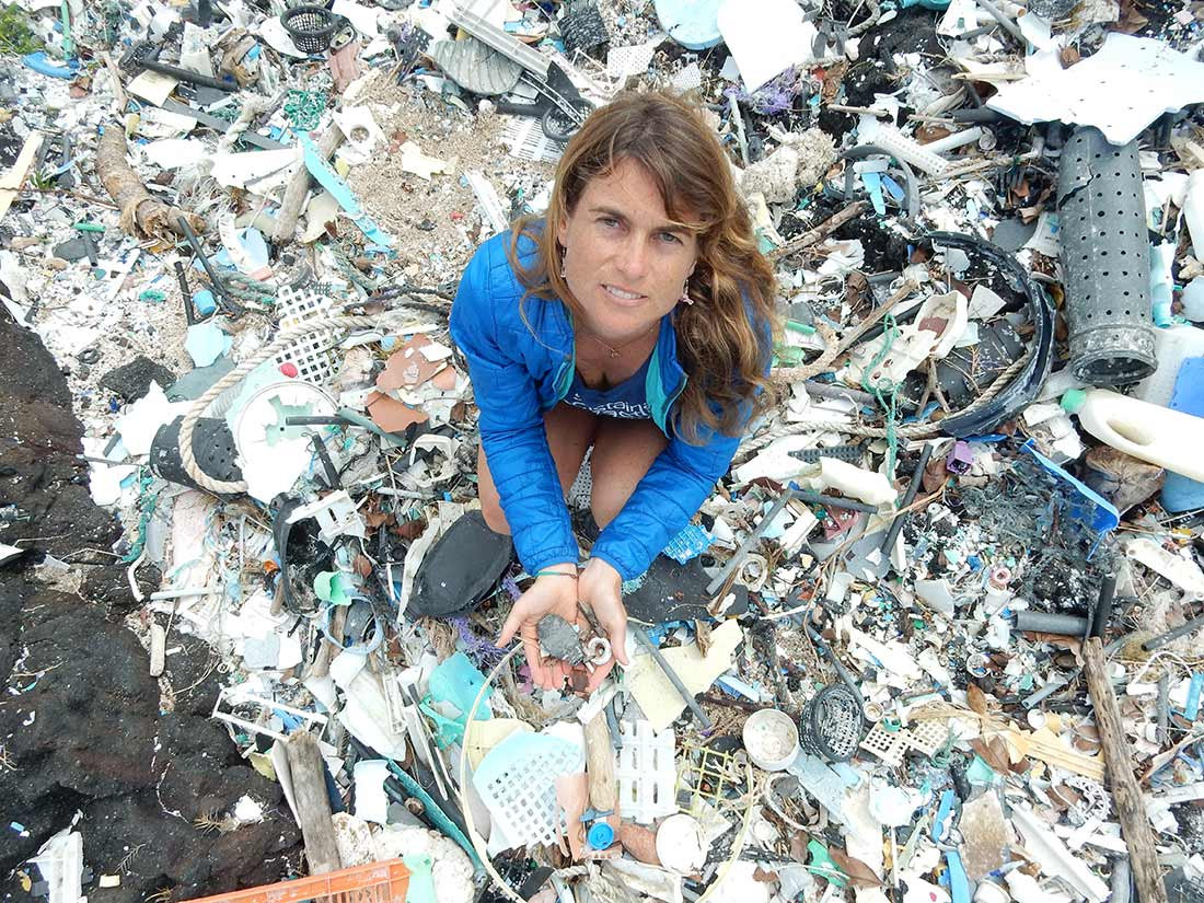 Sarah-Jeanne Royer kneeling down holding microplastics