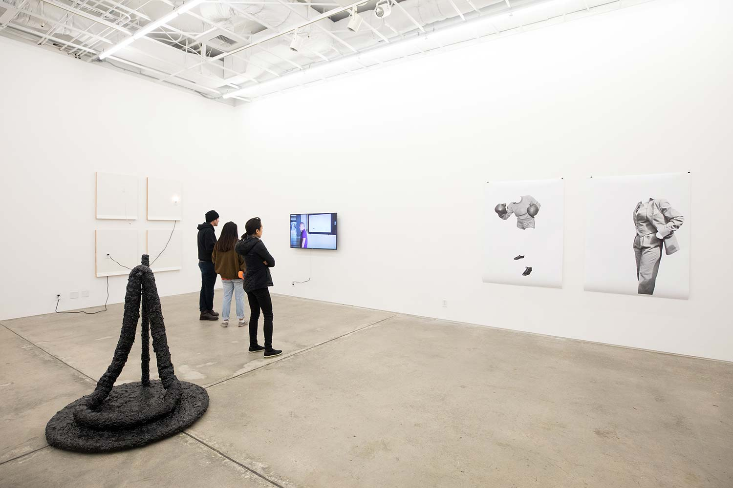 people viewing art in Visual Arts Facility Gallery