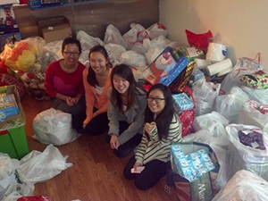 Image: Members of Operation Santa with gifts before making deliveries to families in need.