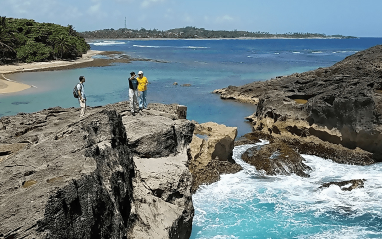 Students survey the coastline of Puerto Rico