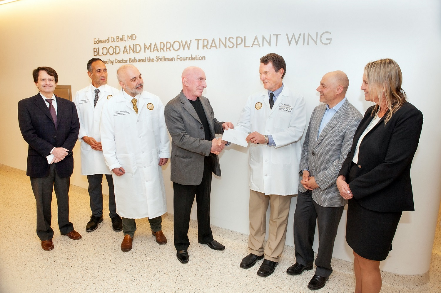 Dr. Bob and Dr. Ball in front of new sign for Blood and Marrow Transplant Wing