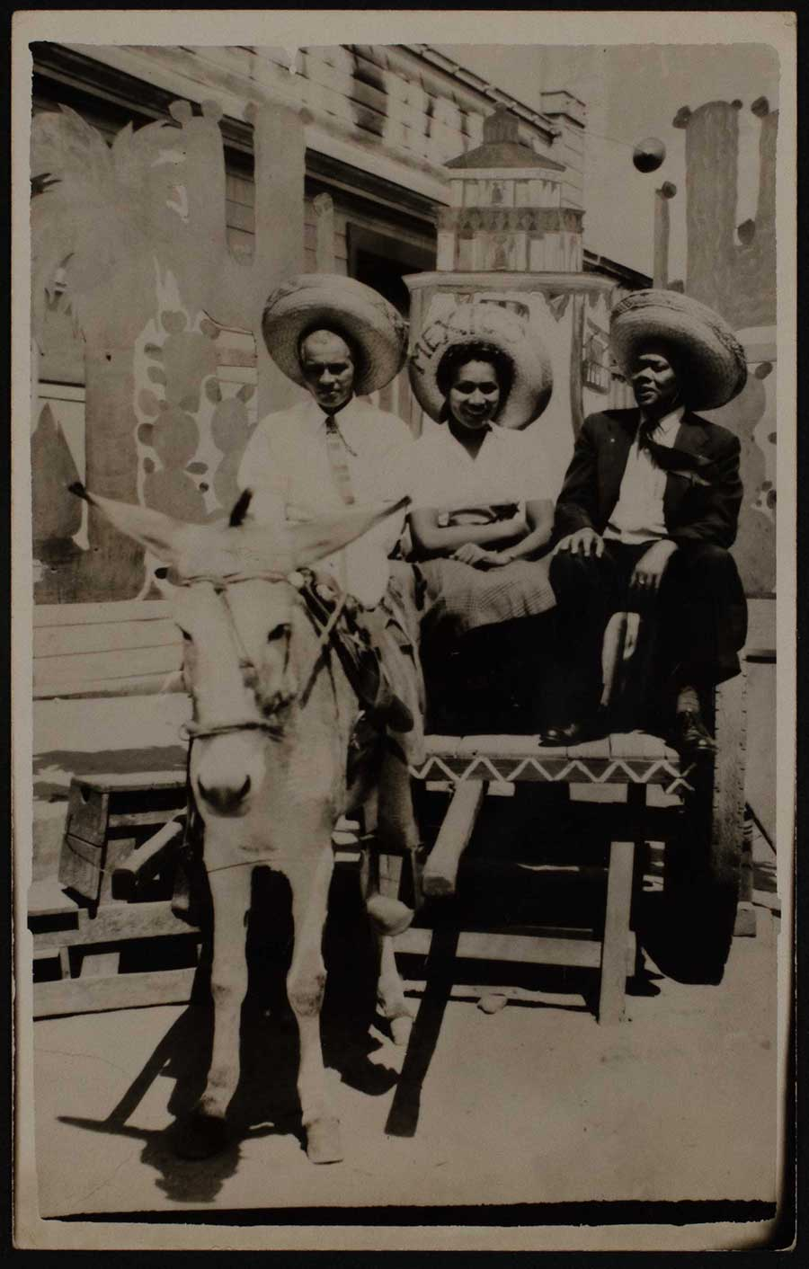 Photocard of African-American tourists in Tijuana, Mexico.