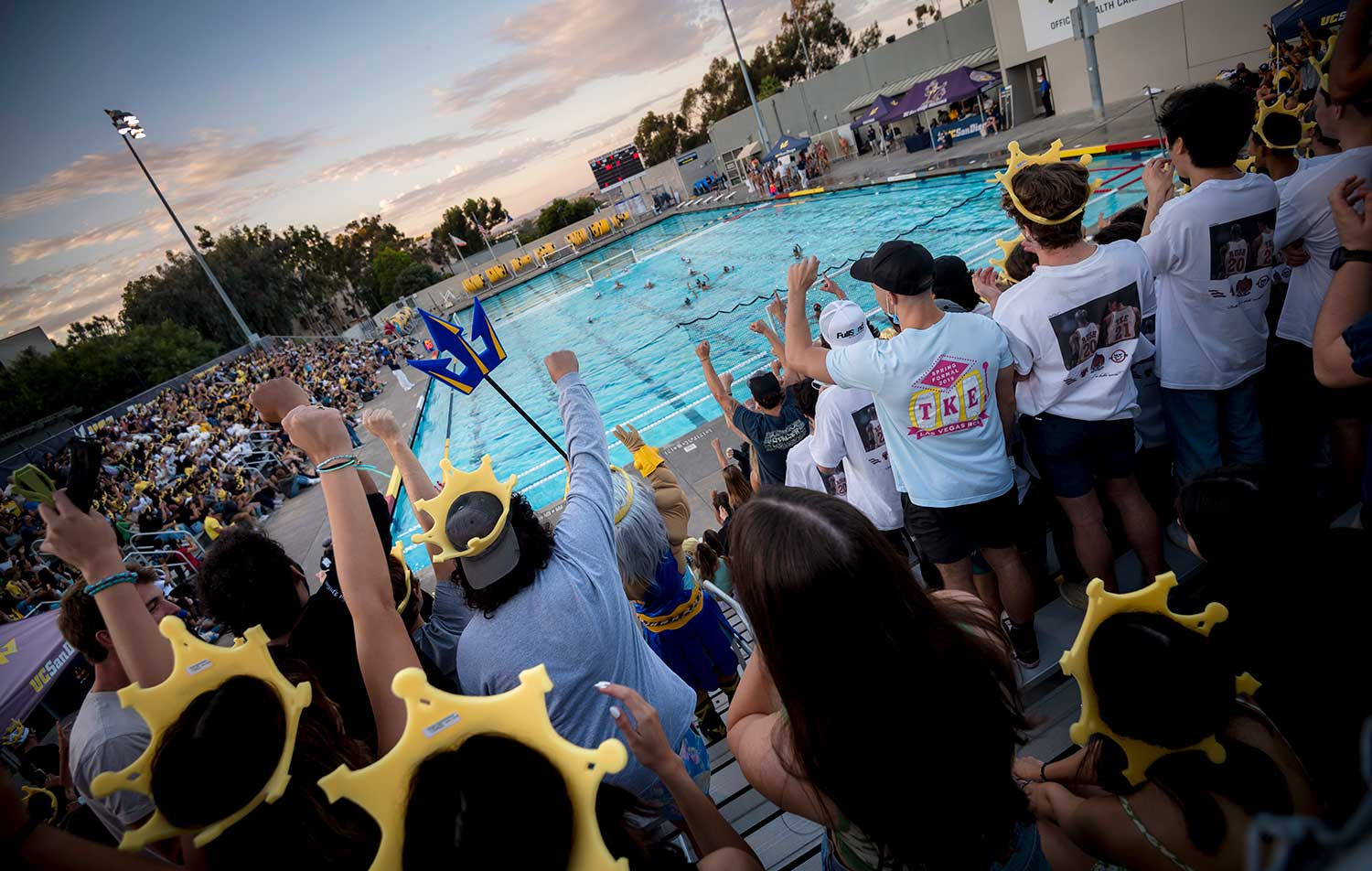 spirited fans in the stands at Canyonview Aquatic Center.