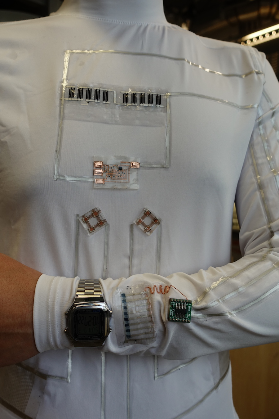 Stretchable electronics on a white long sleeved shirt