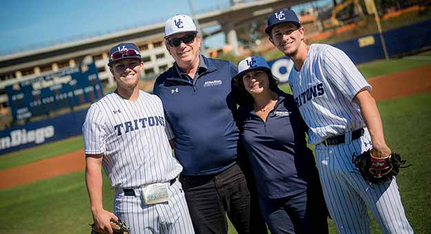 Gary and Jerri-Ann Jacobs with Triton baseball players