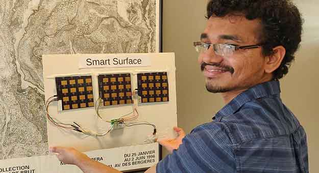 man holding up smart surface device
