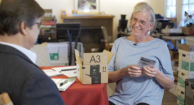 Woman with opened Amazon package