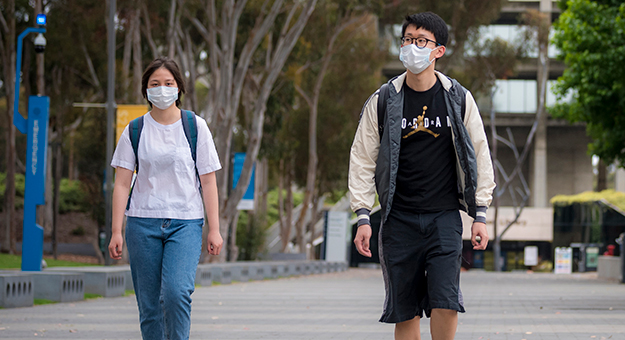 ucsd students walking with facemasks