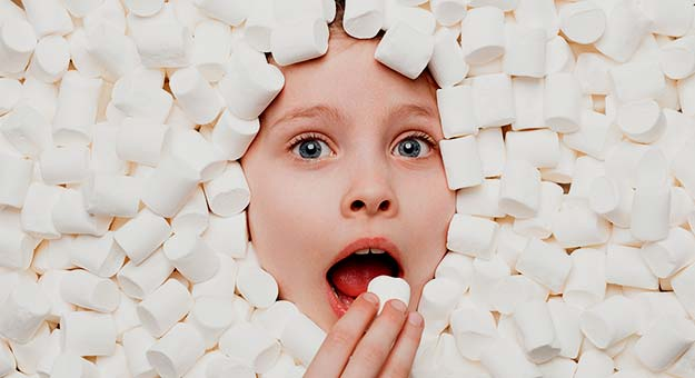 child with marshmellows.