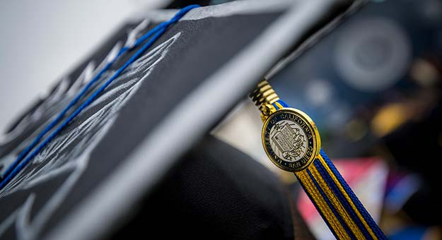 UC mortar board and tassel.
